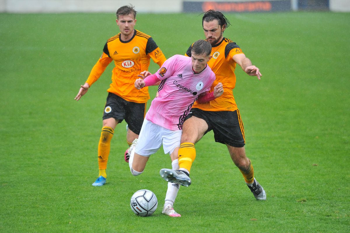 James Hardy of Telford is tackled during the Vanarama Conference North fixture between AFC Telford United and Boston United