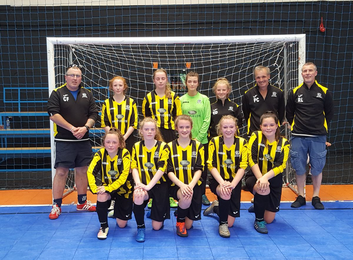 Back row: Manager Colin Fisher, Eve Williscroft-Tate, Hannah Fisher, Holly Williams, Erin Davies and coaches Paul Chiltern and Ri Lenc. Front row: Kate Heathorn, Molly Lenc, Isla Davidson, Ella Paddock and Jas Challinor