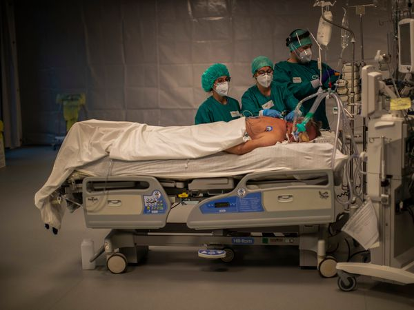 Medical personnel work in the intensive care ward for Covid-19 patients at the MontLegia CHC hospital in Liege, Belgium (Francisco Seco/AP)