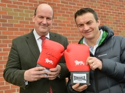 Boxing champ's glove raises £200 for cancer fight