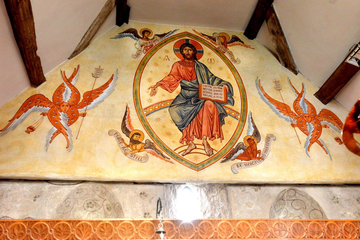 The large mural above the altar, previously created by Aidan Hart