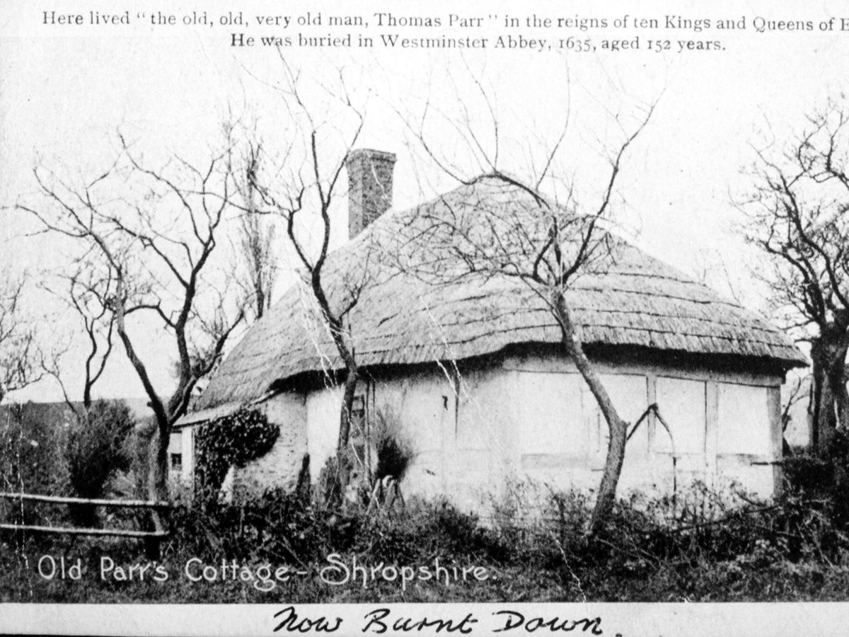 nostalgia pic. Middletown area. Old Parr's Cottage, Shropshire. This is a Wildings postcard, probably Edwardian. The note on the bottom says 'now burnt down' but it appears to have been rebuilt. Thomas Parr was buried in Westminster Abbey in 1635 and was said to be 152 years of age. Postcard from Ron Davies of Minsterley. Library code: Middletown nostalgia 2005.