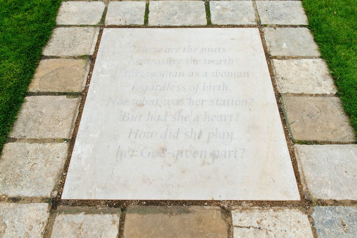 A paving stone engraved with an extract inspired by The Measure of A Man poem