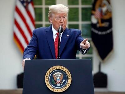 Trump extends coronavirus shutdown as US death toll hits 2,400