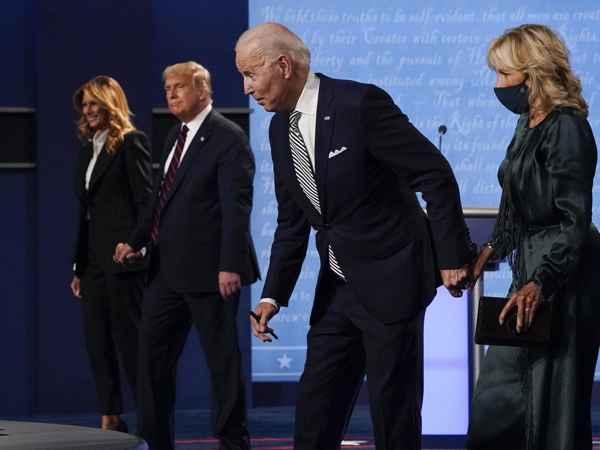 From l-r, first lady Melania Trump, President Donald Trump, Democratic presidential candidate former Vice President Joe Biden and Jill Biden, walk off stage at the conclusion of the first presidential debate