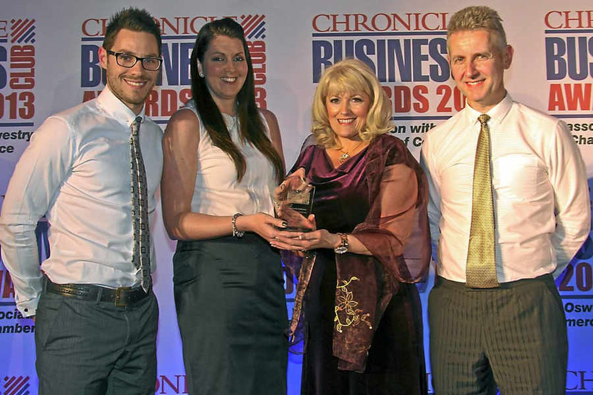 Winners the British Ironwork Centre, from left, Ben Knowles, Lyn Pearson,of The Lion Quays, presenting, Tracy Knowles, Clive Knowles