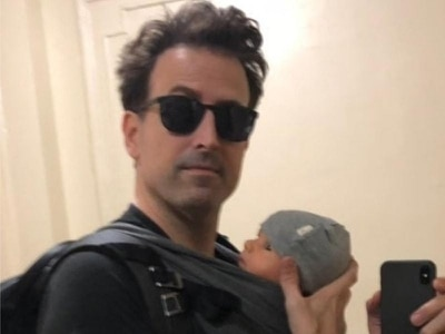 Fathers are calling out Piers Morgan by showing off their baby carriers