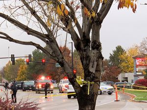 Police close off a street outside a shopping centre after a shooting in Boise, Idaho (Rebecca Boone/AP)