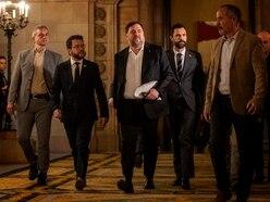 Ex-Catalonia vice-president returns to parliament as serving prisoner