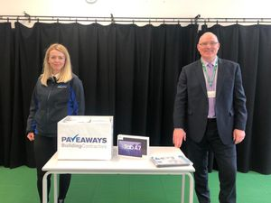 Pave Aways' Finance Manager Charlie Davies with Steve Carter, Head Teacher of the Telford Langley School and the tablets the firm has donated