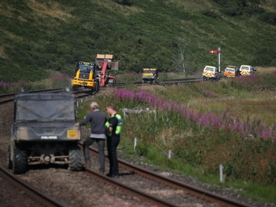 Johnson and Sturgeon lead tributes as PM says rail crash must never happen again