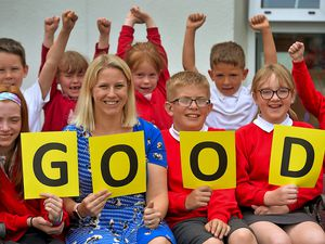 Headteacher Charlie Summers celebrates the 'good' inspection with students at The Grange Primary School