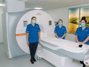 MRI radiographers Meg Evans, Jodie Rogers and Gemma Jones with the new MRI scanner