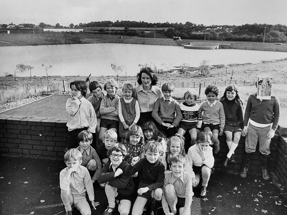 These Telford youngsters with their teacher Mrs Kate Mansell will all be middle aged now, because we are going back to October 1973 here. The photo was taken at Holmer Lake First School in Brookside. The lake is in the background, along with the eastern primary road.