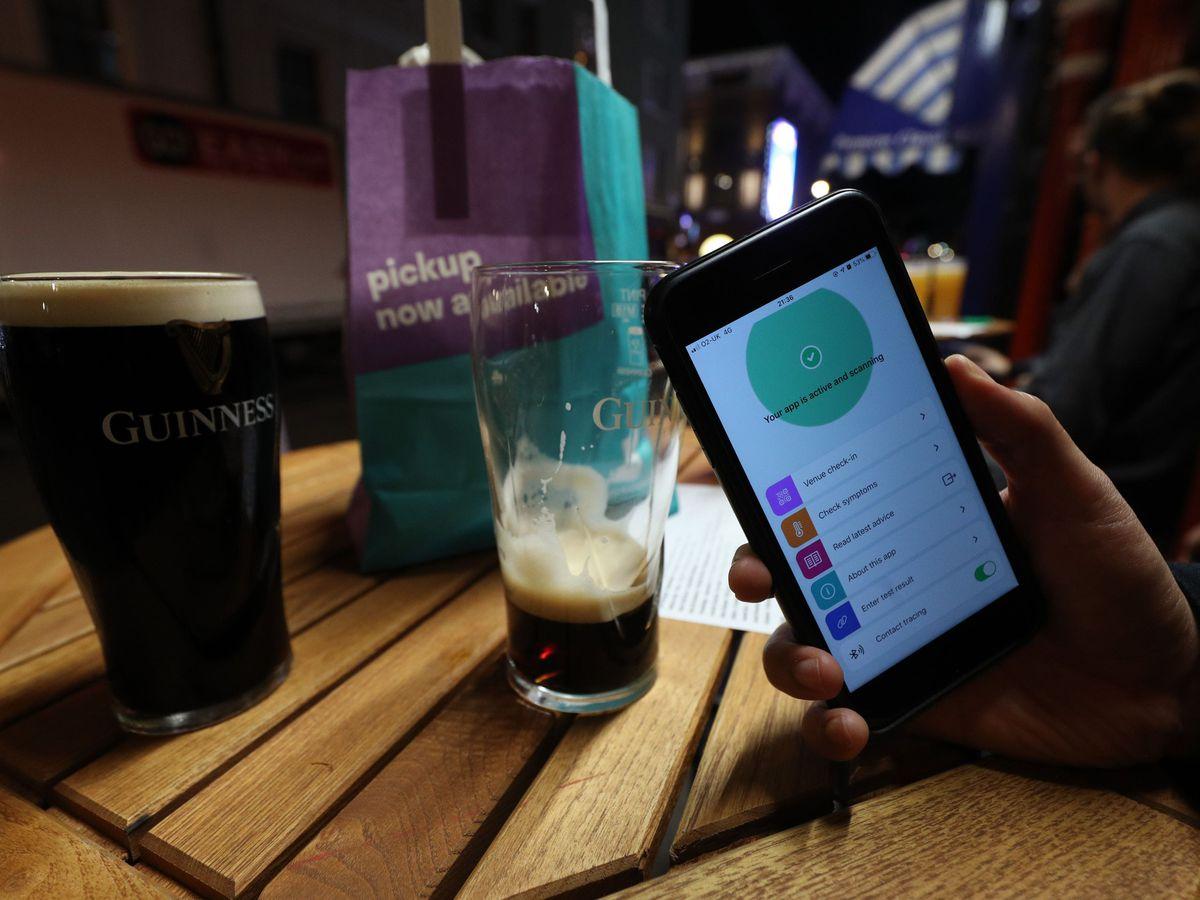 Person using smartphone app in pub