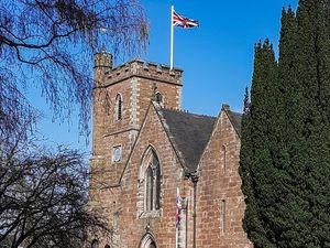 The flag flying at Christ Church in Little Drayton