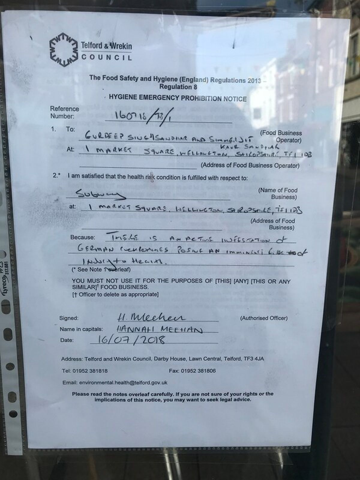 A notice placed in the window of Subway
