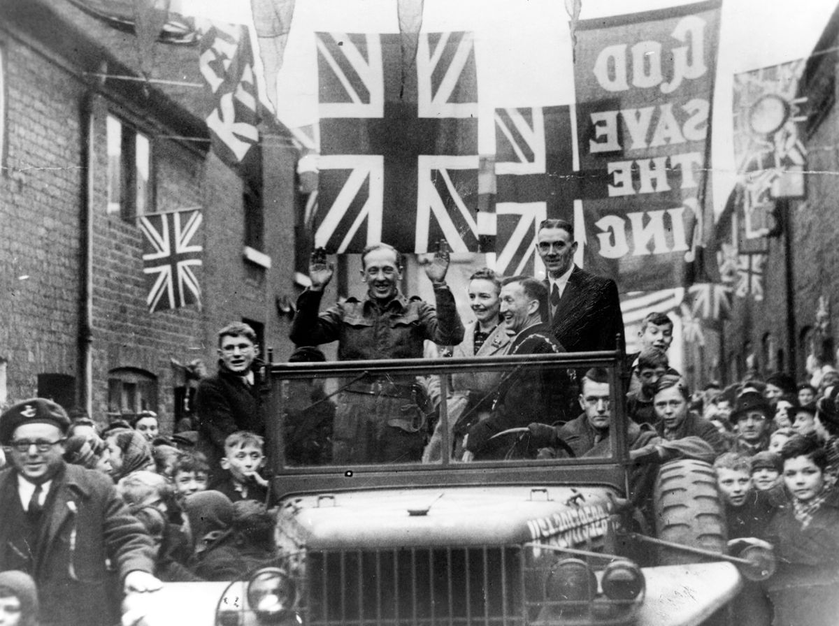 Home comes the hero. George Eardley, VC, was feted by crowds on his return