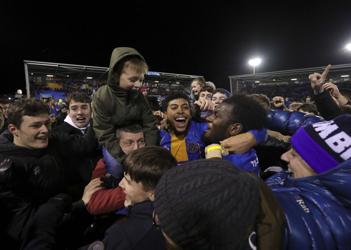 Josh Laurent, who has joined Reading, celebrates with Town fans after the FA Cup win over Bristol City (AMA)