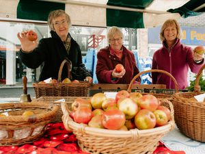 From left, Valentine Davis, Smita Kulkarni and Kathy Watkins enjoy a taste of the good life during Apple Day at Oswestry Market