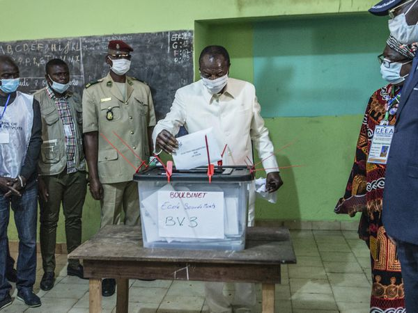 Guinean President Alpha Conde casts his ballot