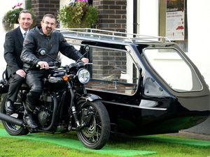 Funeral director Paul O'Brien and biker Simon Kelly on the bike hearse