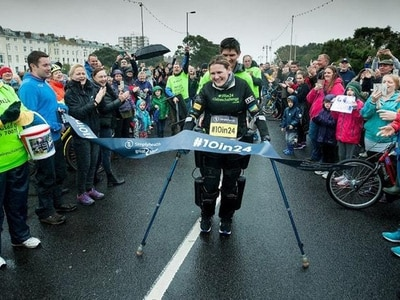 Woman paralysed from chest down triumphs in Great South Run using bionic suit