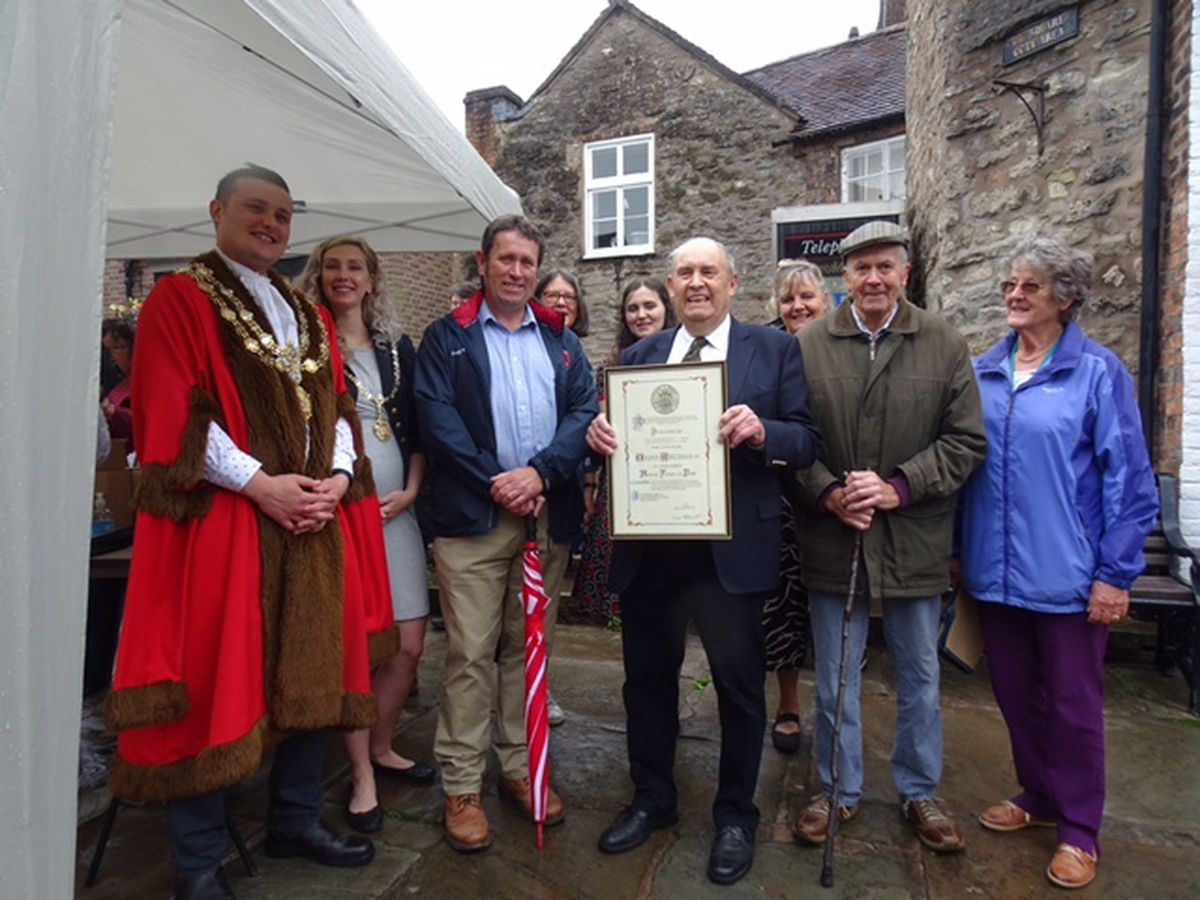 Much Wenlock mayor Councillor Dan Thomas with Milner Whiteman and members of his family