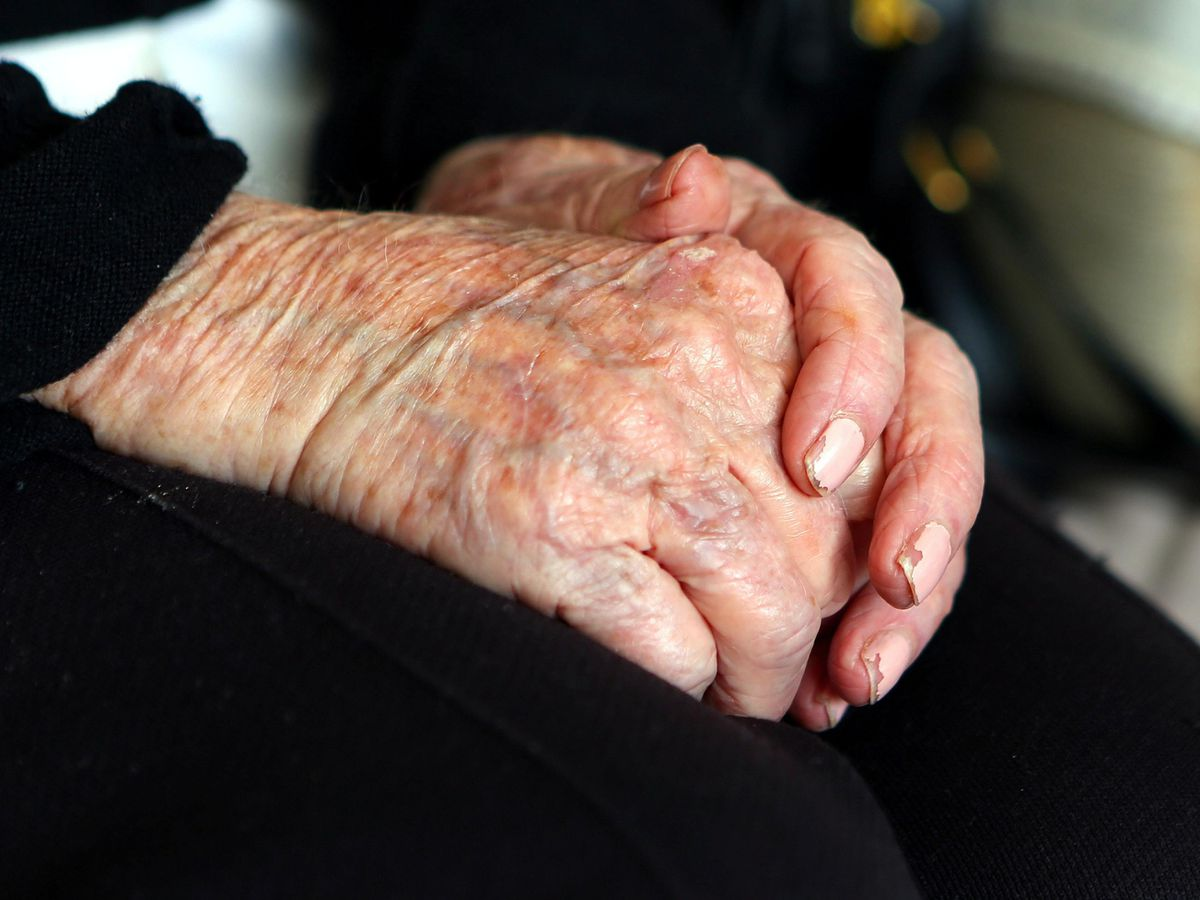 Elderly person's hands in their lap