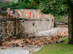 Homes flooded and wall collapses amid storms drama