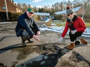 Philip and Debbie Lloyd show the potholes in Broseley