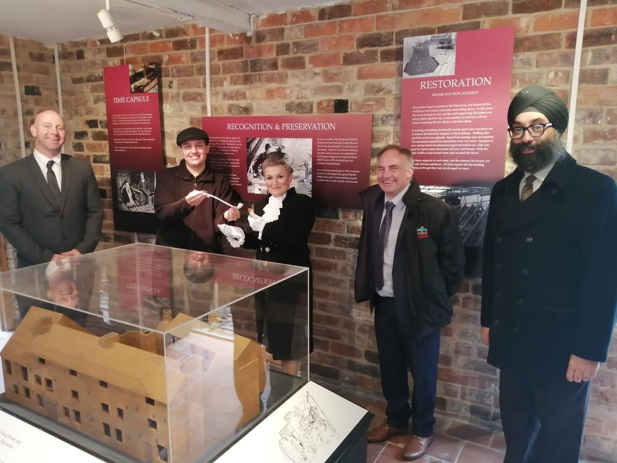 Deputy mayor of Broseley councillor Mark Garbett, left, Shropshire High Sheriff Dean Harris, centre, and town mayor councillor Tarlochen Singh-Mohr, right, with members of Broseley Pipeworks museum
