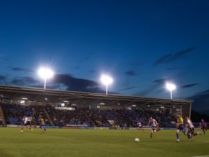 Action in the Montgomery Waters Meadow Stadium, the home of Shrewsbury Town.