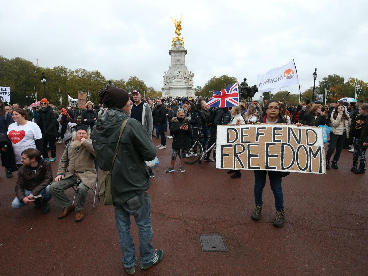 Demonstrators gathered outside Buckingham Palace for a protest against coronavirus restrictions (Jonathan Brady/PA)
