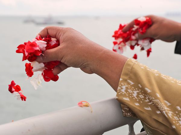 Relatives sprinkle flowers into the Java Sea where Sriwijaya Air flight SJ-182 crashed on January 9
