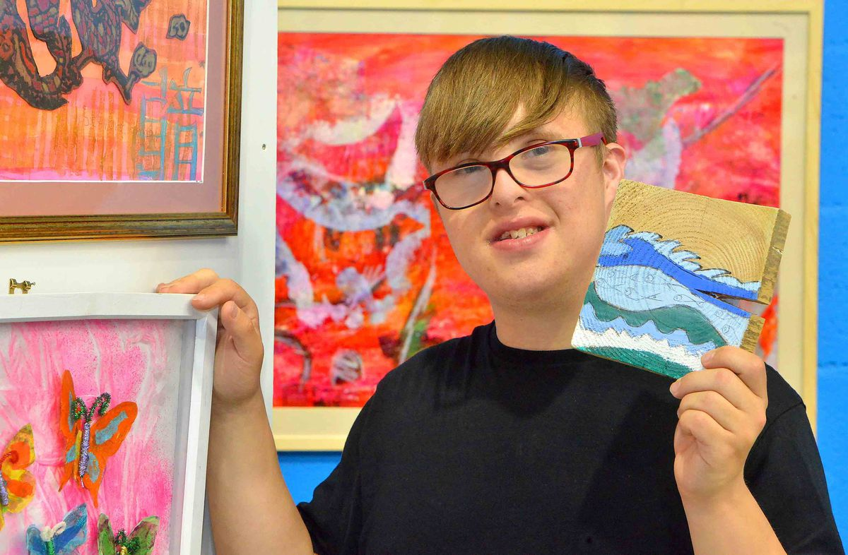 Thomas Shacklady 23 with some of his art and other students work