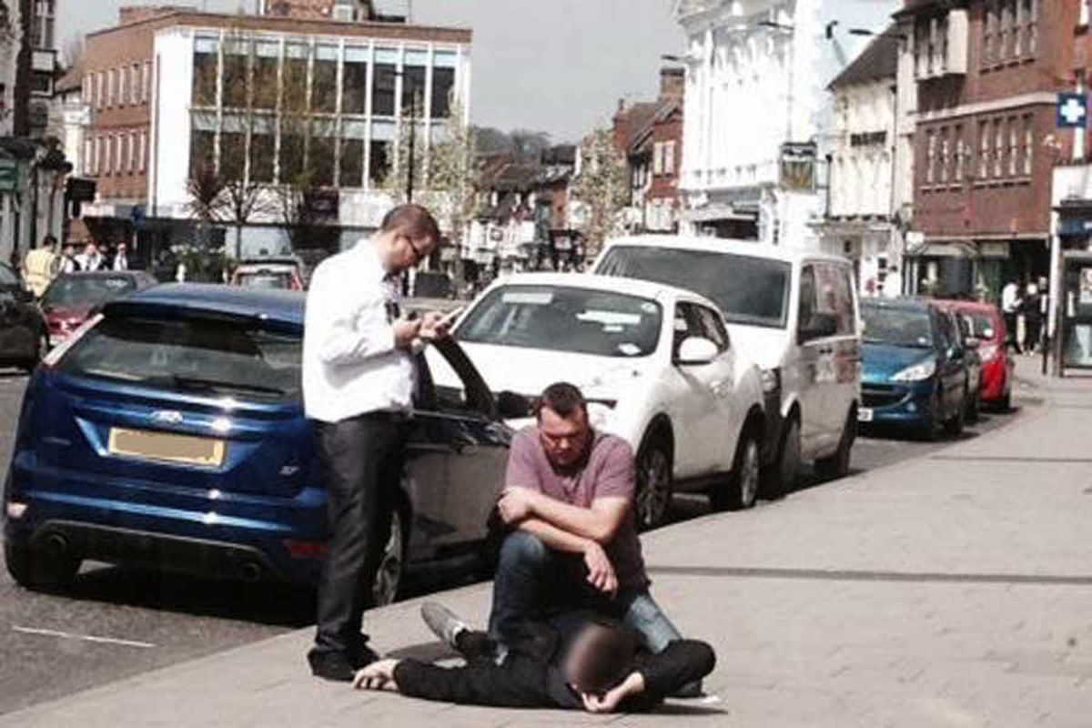 Newport store detective wrestles shoplifting suspect to the ground