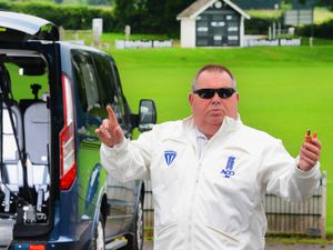 Telford cricket umpire John McIntear has now reached his fundraising target for an electric wheelchair