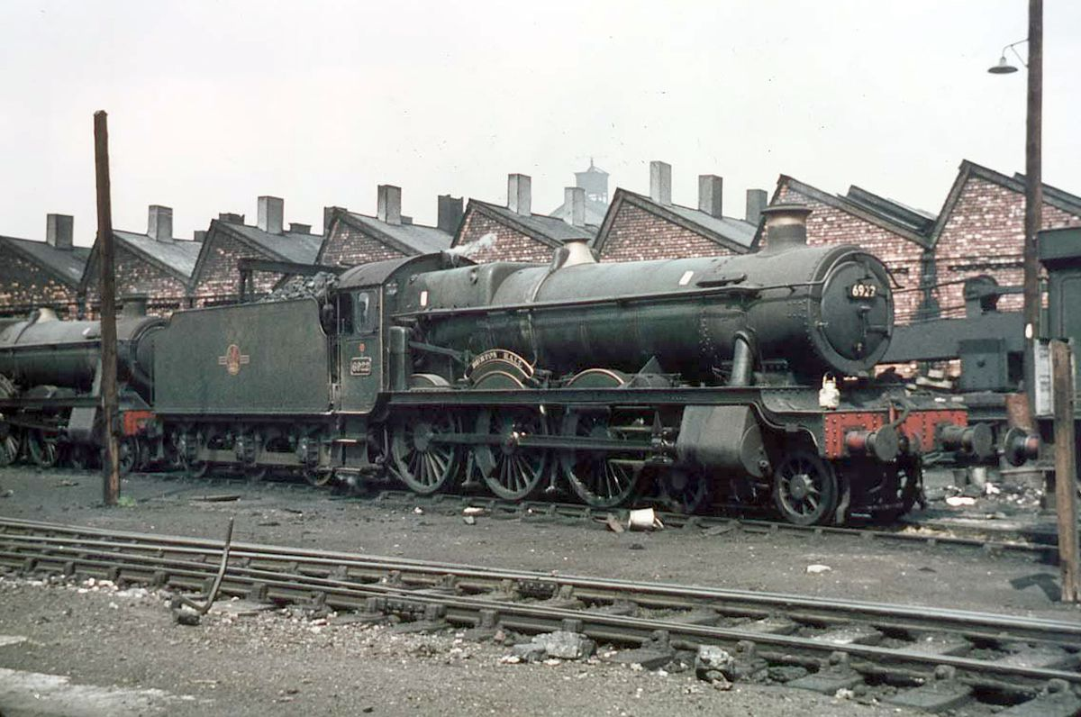 """Steam buffs know their stuff so, on seeing that this loco pictured at the Shrewsbury sheds around the early 1960s is loco number 6922, will no doubt be able to provide chapter and verse about it. We can't quite make out the nameplate, but the last word of the loco's name is """"Hall."""" And it is a GWR Class engine."""