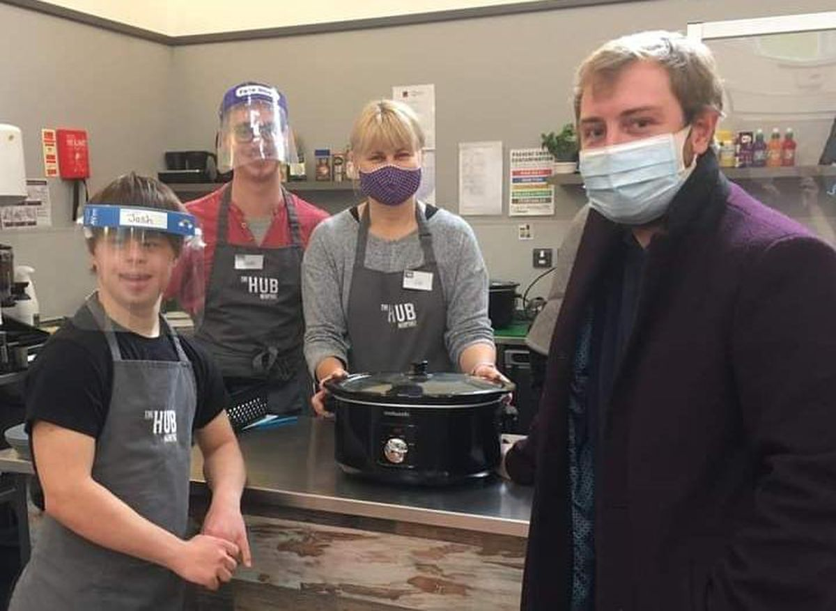 With the new slow cooker are, from left to right: Josh Bickford-Smith, Luke Pugh, Liz Bickford-Smith and councillor Thomas King