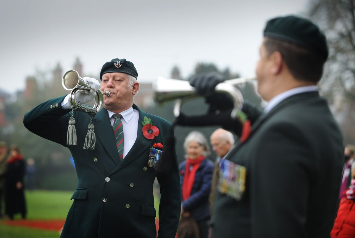 Playing the Last Post (left-right) John Henry Plumridge and Steve Jones, of the Veteran Buglers