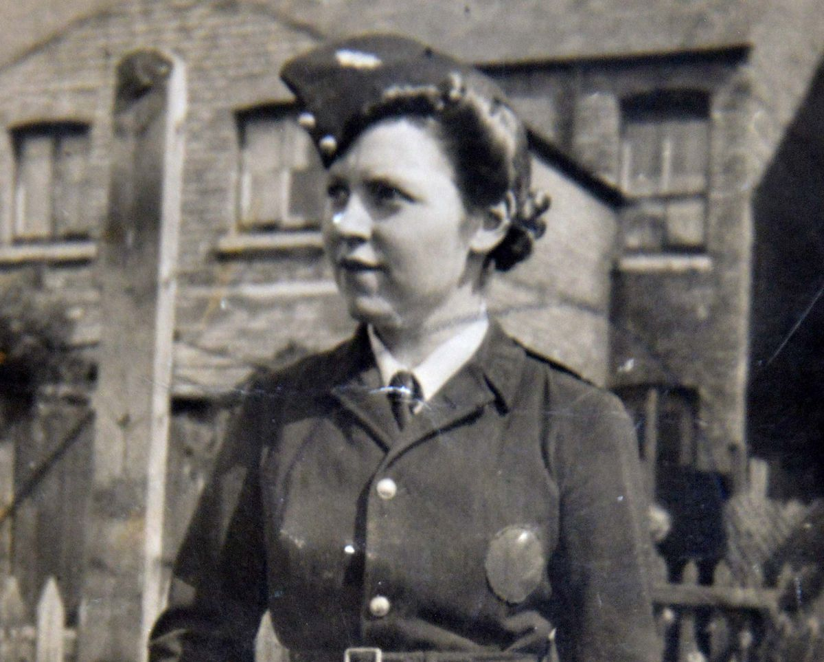 NORTH COPYRIGHT SHROPSHIRE STAR STEVE LEATH 17/07/2021..Pic in Muckleton, Shawbury, where Edna Taylor was celebrating her 100th birthday, Here pictured in her war uniform when she was a firefighter aged in her 20s..