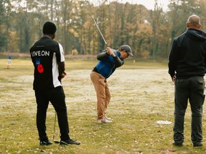 Golf pro Mark Shervill teaches armed forces personnel how to play golf