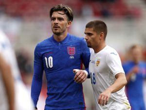 England's Jack Grealish and Romania's Razvan Marin during the international friendly match at Riverside Stadium, Middlesbrough. Picture date: Sunday June 6, 2021. PA Photo. See PA story SOCCER England. Photo credit should read: Lee Smith/PA Wire.   Use subject to FA restrictions. Editorial use  only. Commercial use only with prior written consent of the FA. No editing except cropping.
