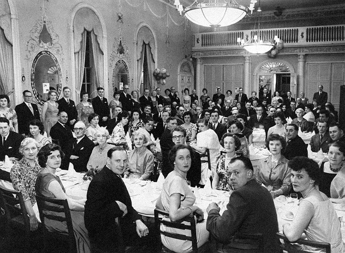 Although our information is that this is the annual dinner of the staff of Shropshire District of the West Midlands Gas Board at the Adam Ballroom at the Lion Hotel, Shrewsbury, we've also been told that it is the Gas Board Sports and Social Club dinner. The date is 1960 or early 1961. The names of the men (sorry, don't have the women's names) from the left on the top table are Jack Collins, Cliff Bailey, Derek Fallows, unknown, Bill Oldham, unknown, Ted Ryder and Jack Onions.