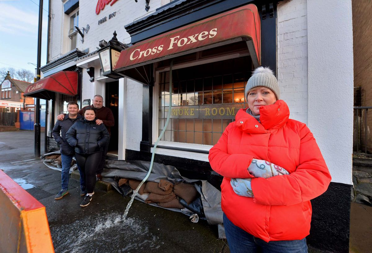 Dawn Lloyd from The Cross Foxes in Shrewsbury where water was being pumped out of the cellar