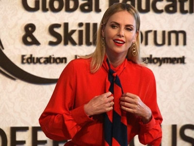 Charlize Theron calls idea of arming US teachers 'outrageous'