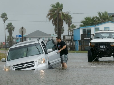 Tropical storm stalls along Texas coast, flooding city streets