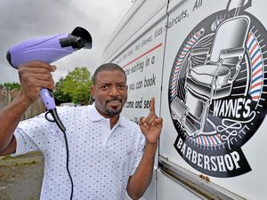 Fresh Look Mobile Barber Wayne Williams is ready to hit the road in his hair-cutting van