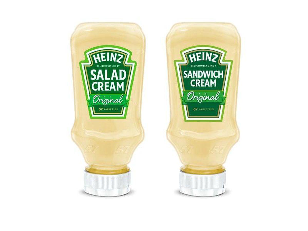 The current Heinz Salad Cream bottle and its now rejected Sandwich Cream alternative (Kraft Heinz/PA)